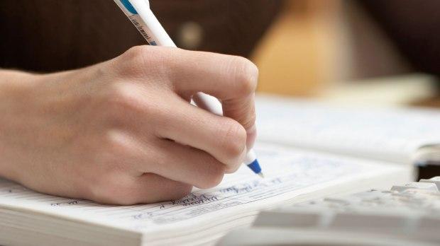 Hand-Writing-in-Journal_iStock_000010636600Medium